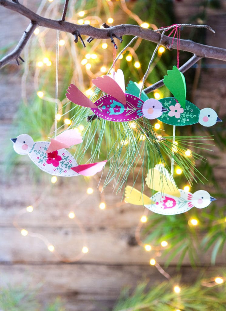 3D paper birds hanging in Christmas tree