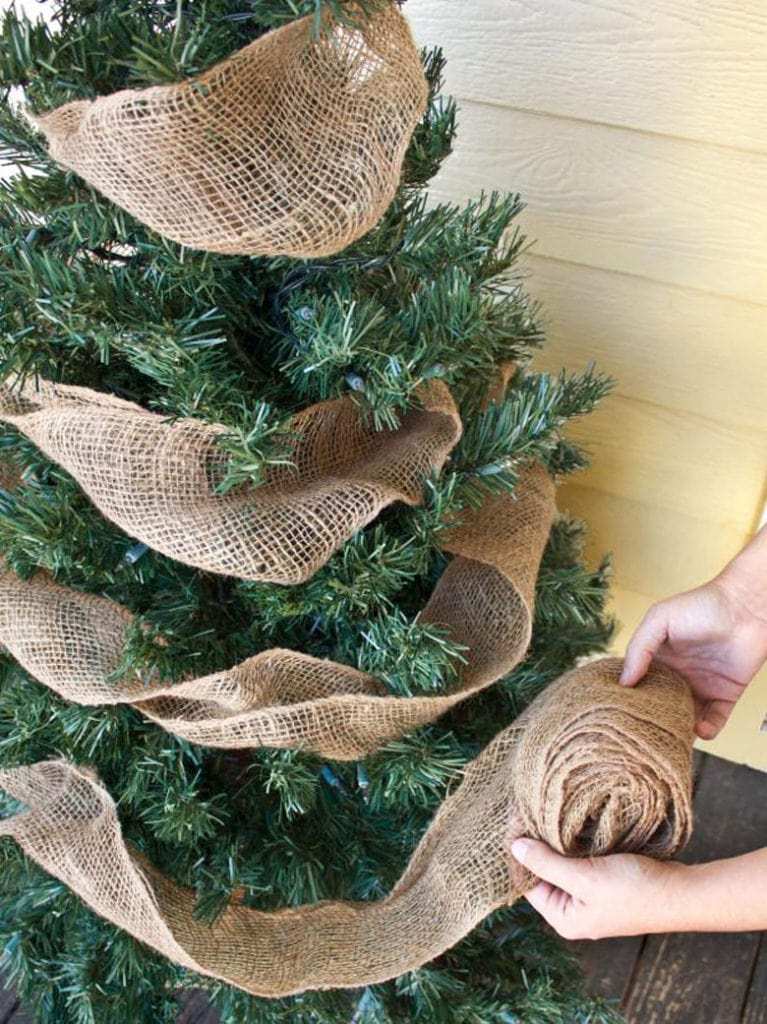how to decorate Christmas trees using burlap ribbons