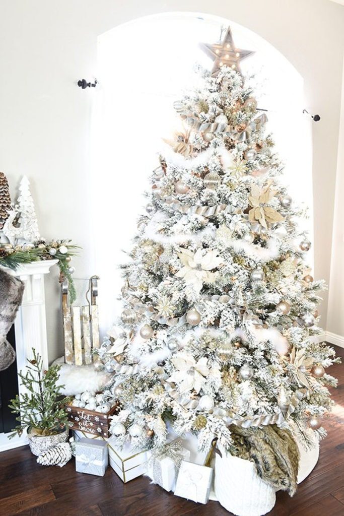 Gold and silver also looks stunning and elegant on a snow flocked Christmas tree