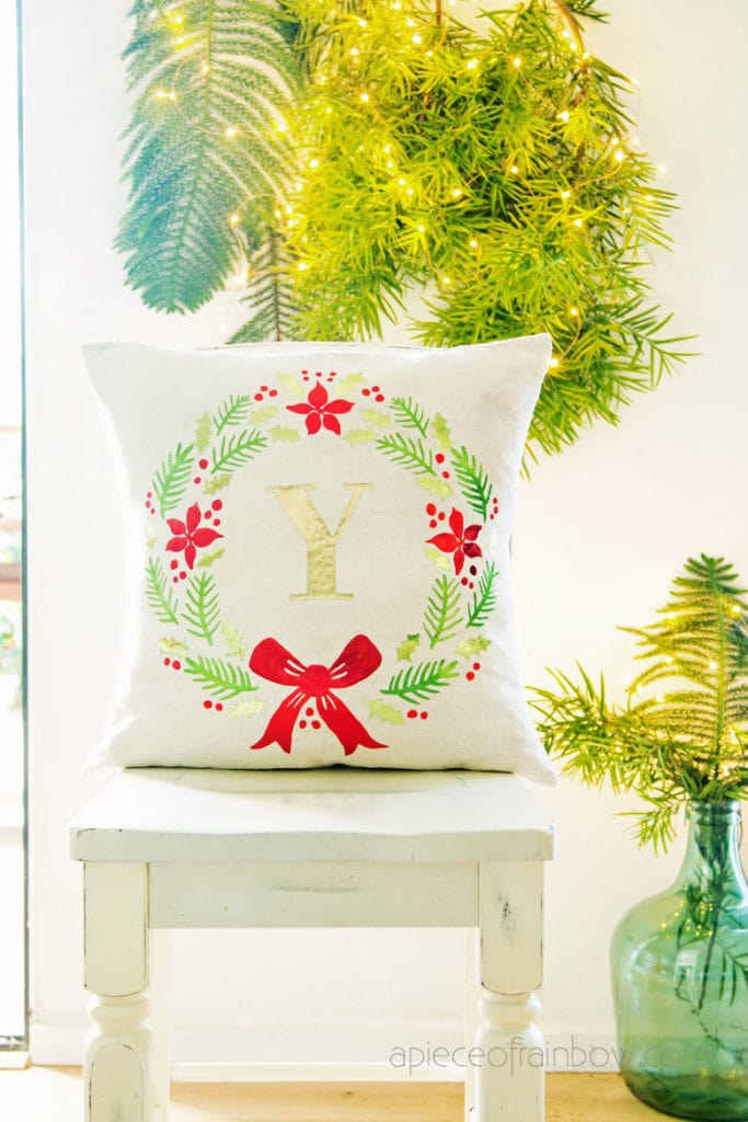 beautiful farmhouse Christmas wreath throw pillow in living room