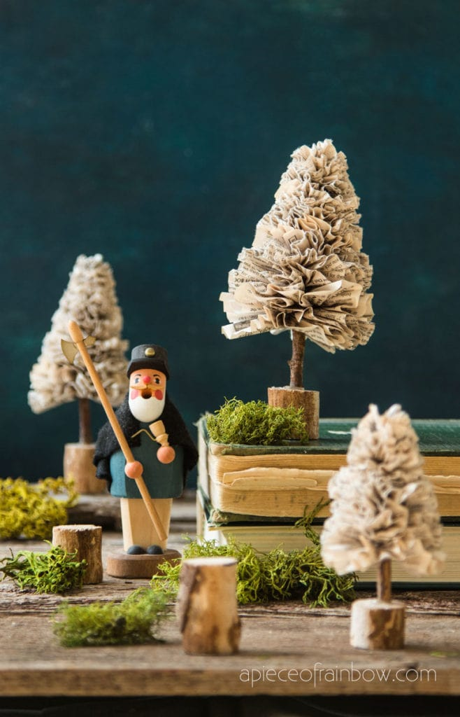 Magical winter wonderland Christmas village with paper Christmas trees  from old book papges