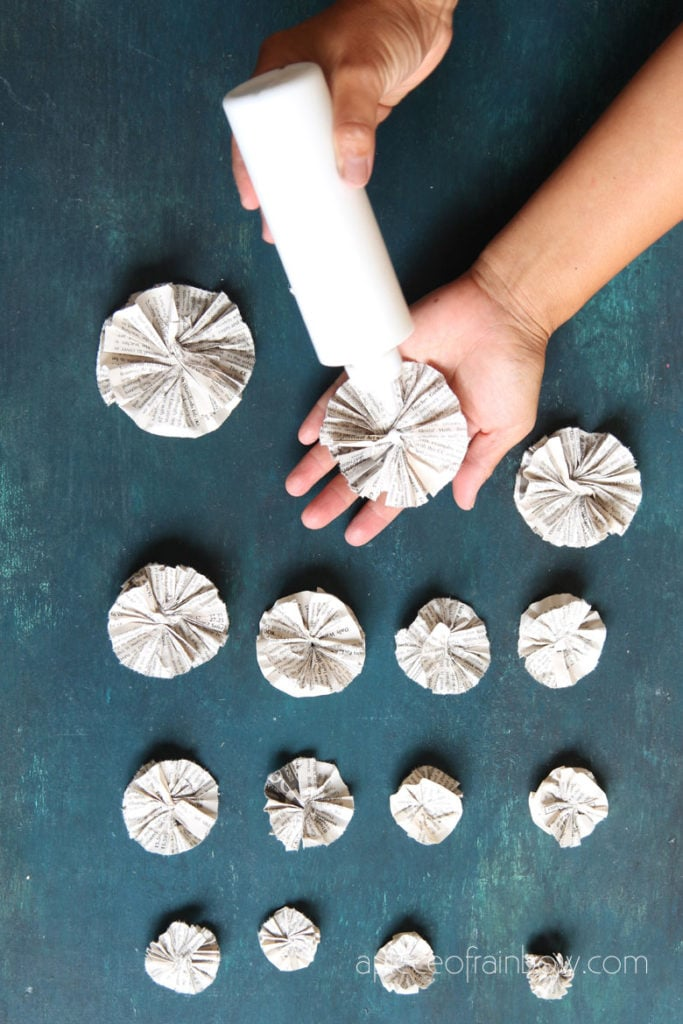 gluing  paper rosettes in a stack
