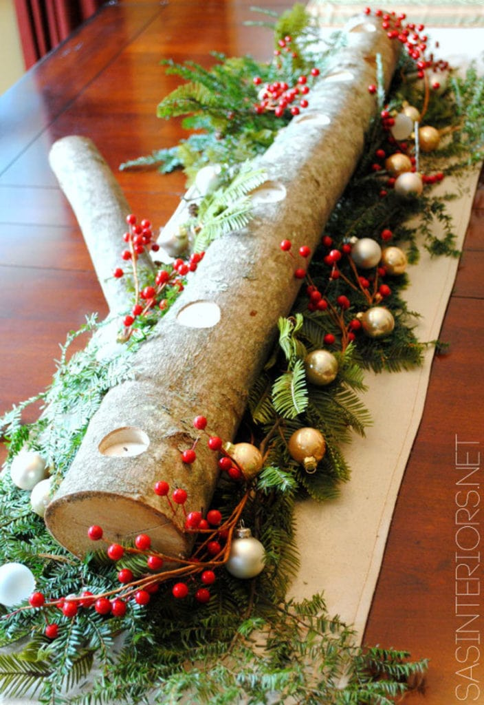 Make a Christmas table centerpiece with candles and a DIY log candle holder