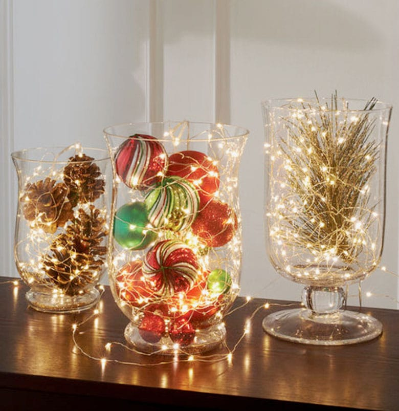 glass hurricane vases with conifer branches, LED candles, pine cones, or LED fairy lights.
