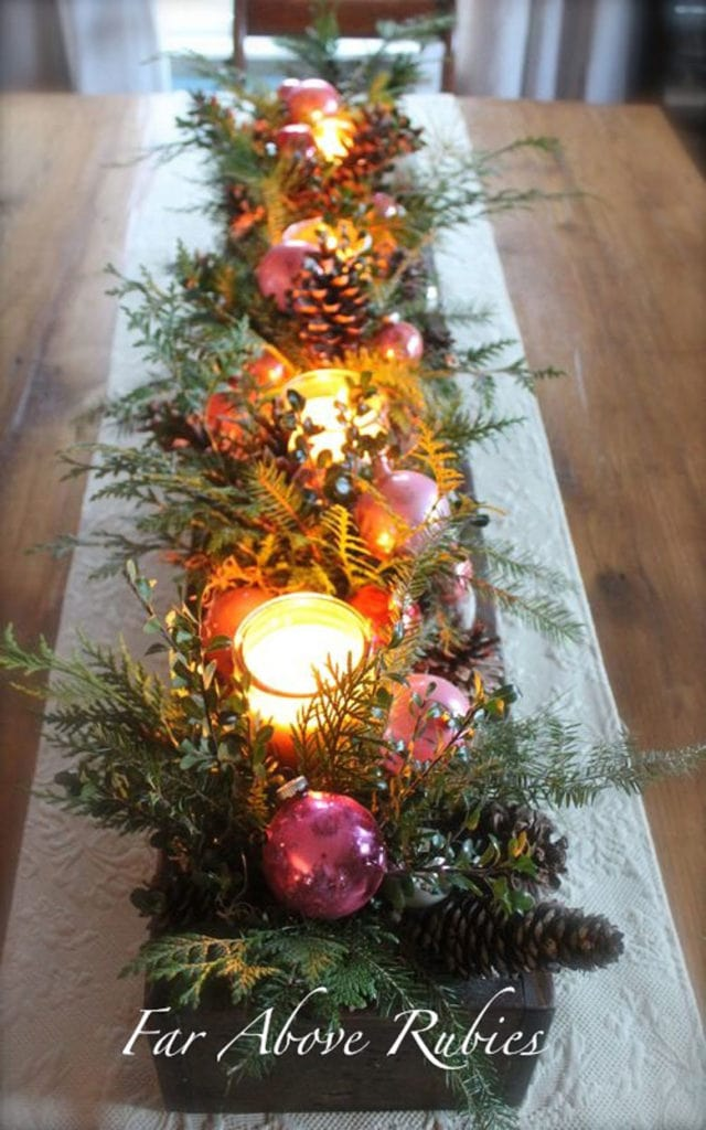 Christmas centerpiece in a long box with candles
