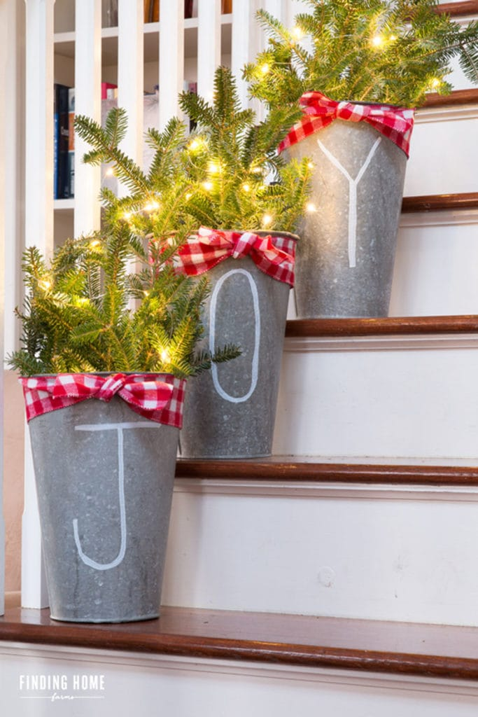 Christmas decorating steps with vintage style galvanized tin vases