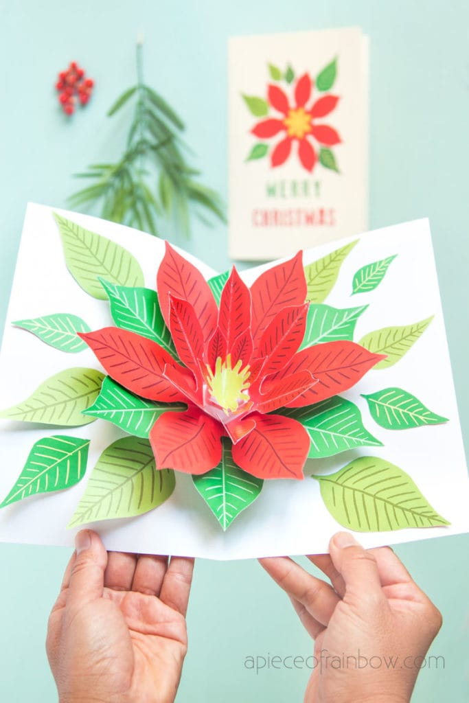 Make an unique DIY pop up Christmas card with a beautiful Poinsettia flower design! Fun & easy Christmas paper craft with free printable templates!