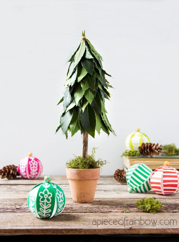topiary style DIY tabletop Christmas tree with fresh leaves & colorful Christmas ornaments