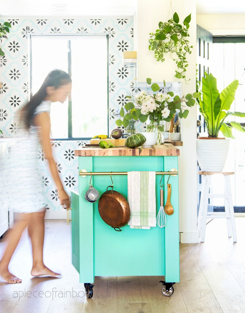 bohemian modern kitchen with colorful plants and blue green DIY kitchen island