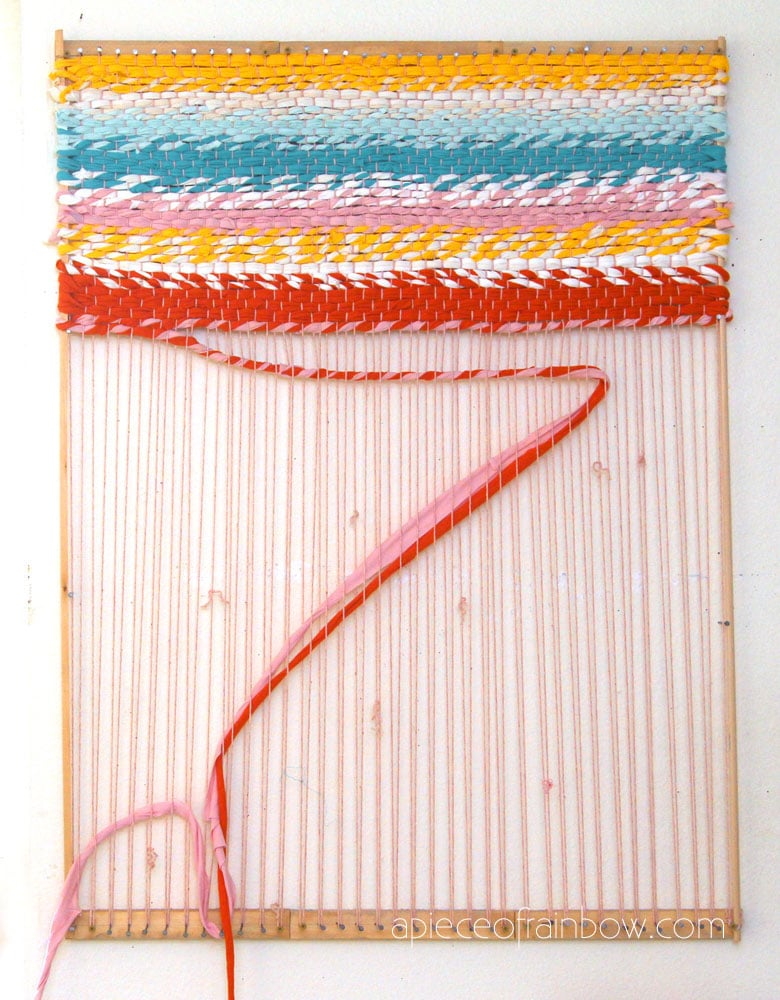 weave a colorful fabric rug