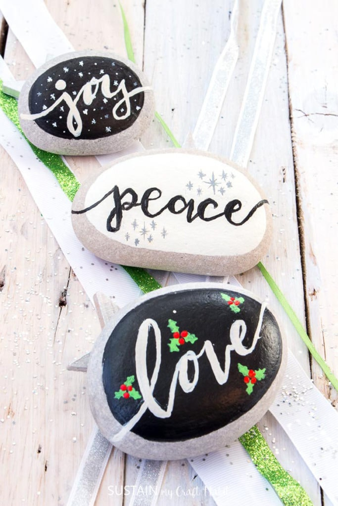 Holiday wishes lettering on rocks