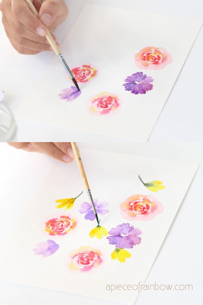 painting purple and yellow flowers in watercolor