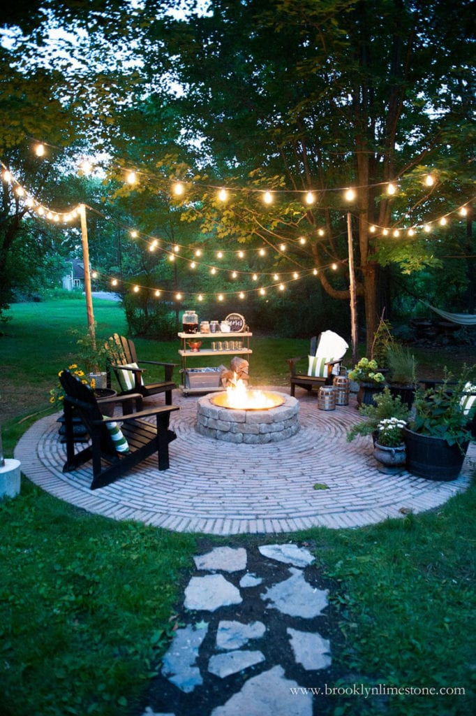 bistro, cafe, market string lights hanging above fire pit in garden