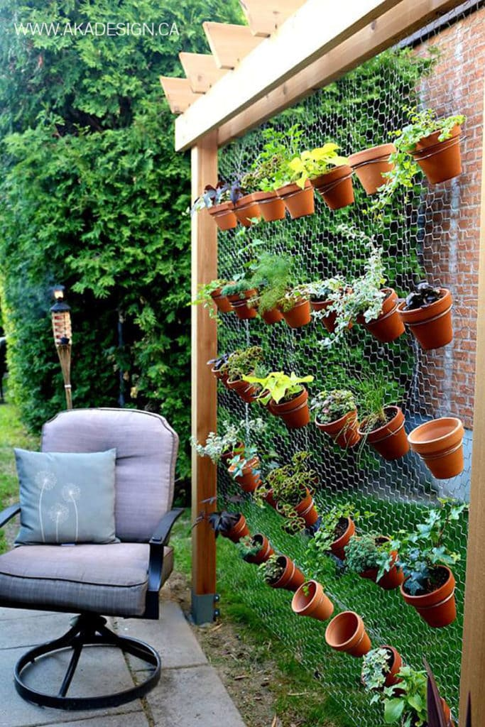 vertical gardens using pots on a garden screen