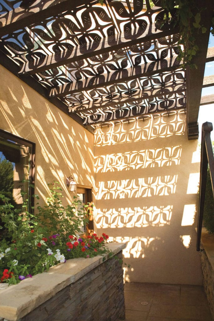 metal pergola shade structures with decorative cutout patterns also create beautiful shadows on walls and floors
