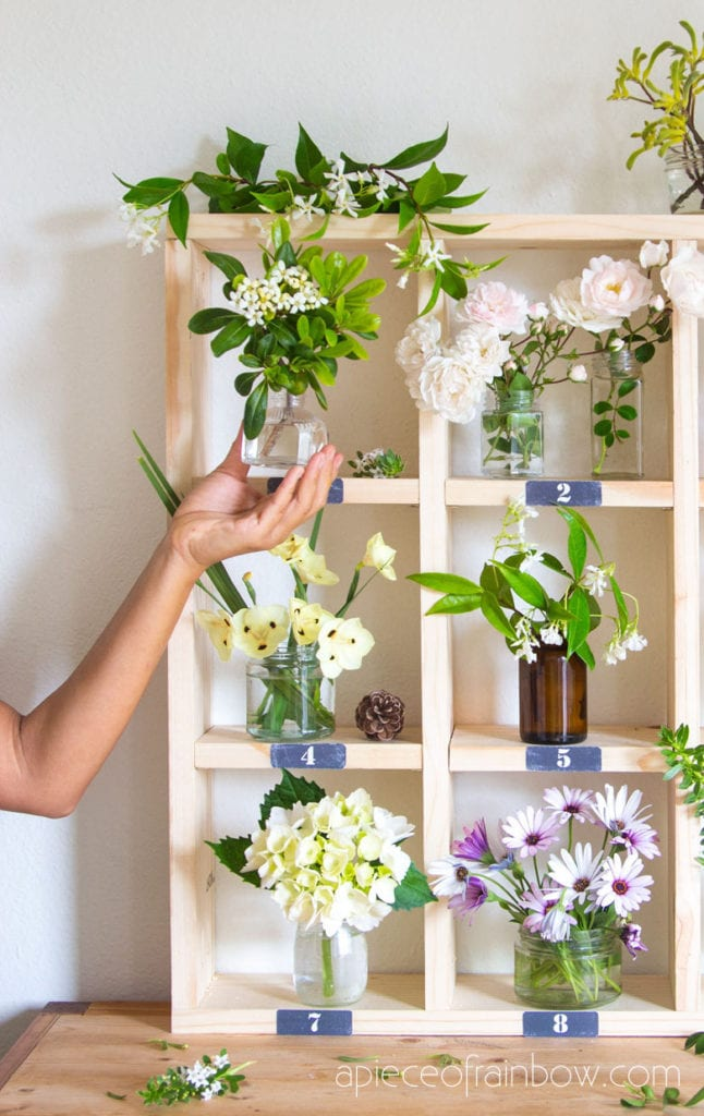 modern farmhouse bohemian cubby shelf with fresh flowers and vases