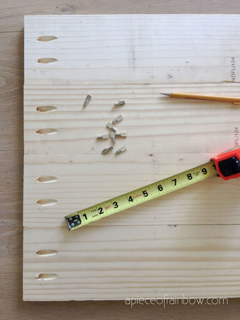 draw a pencil line across wood to mark the bottom of each row of shelves