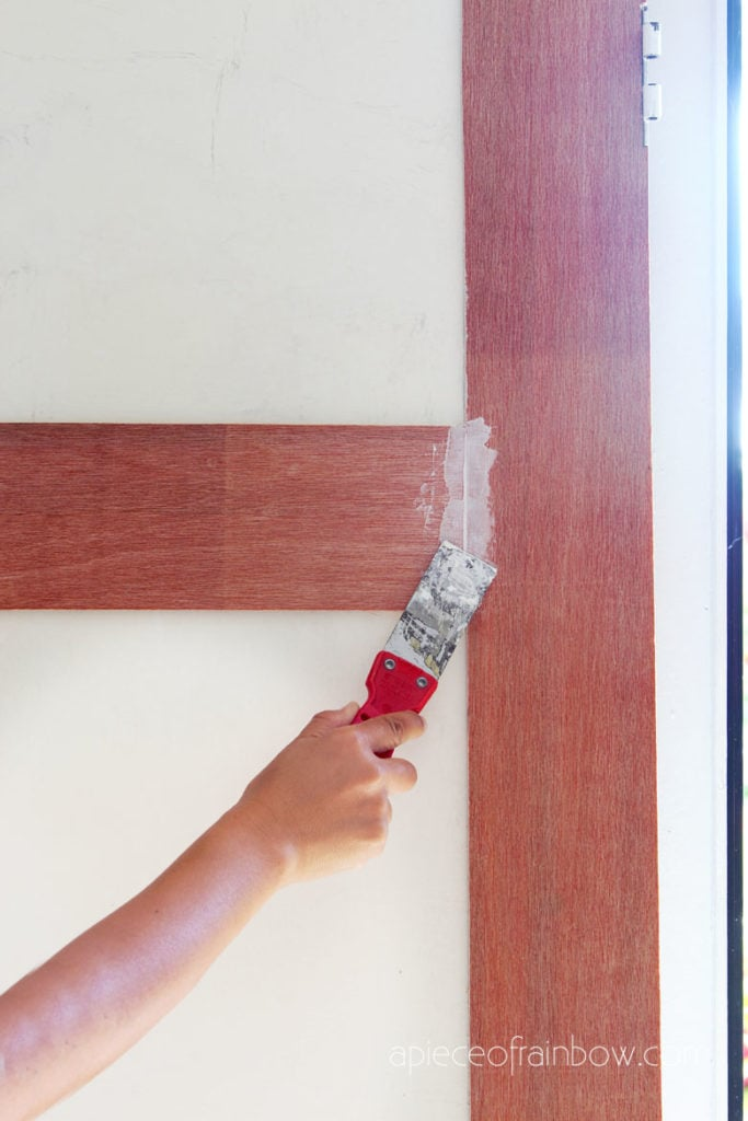 Use spackling paste or joint compound to smooth out any visible gaps.