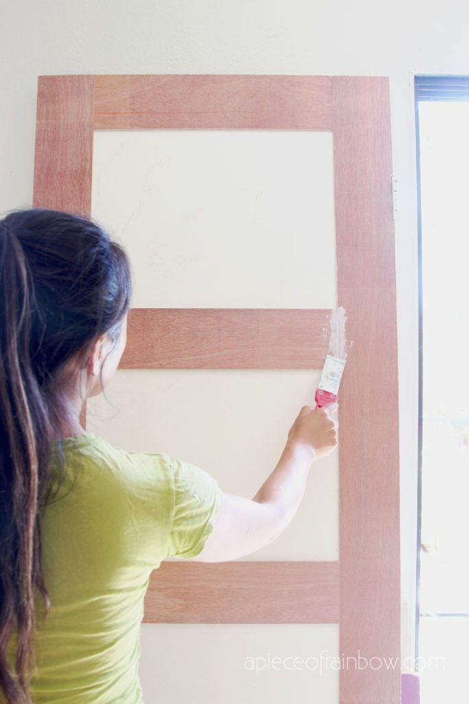 smooth out gaps on door design with  spackling paste or joint compound