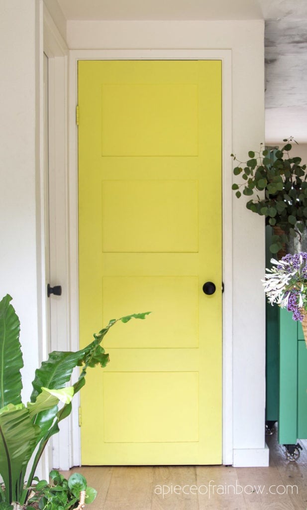 Transform an old hollow core door into boho and farmhouse style DIY painted panel door in vintage yellow lime color