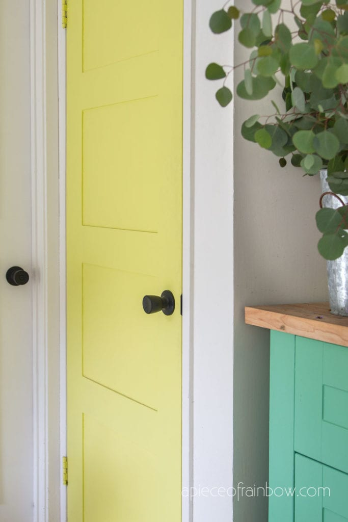 colorful boho and farmhouse style DIY painted lime yellow door  with modern black knob