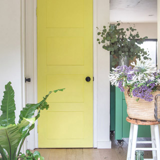 Transform an old hollow core door into boho and farmhouse style DIY painted panel door for under $20! Easy makeover with simple tools and materials. Great home improvement idea on a budget! - A Piece Of Rainbow