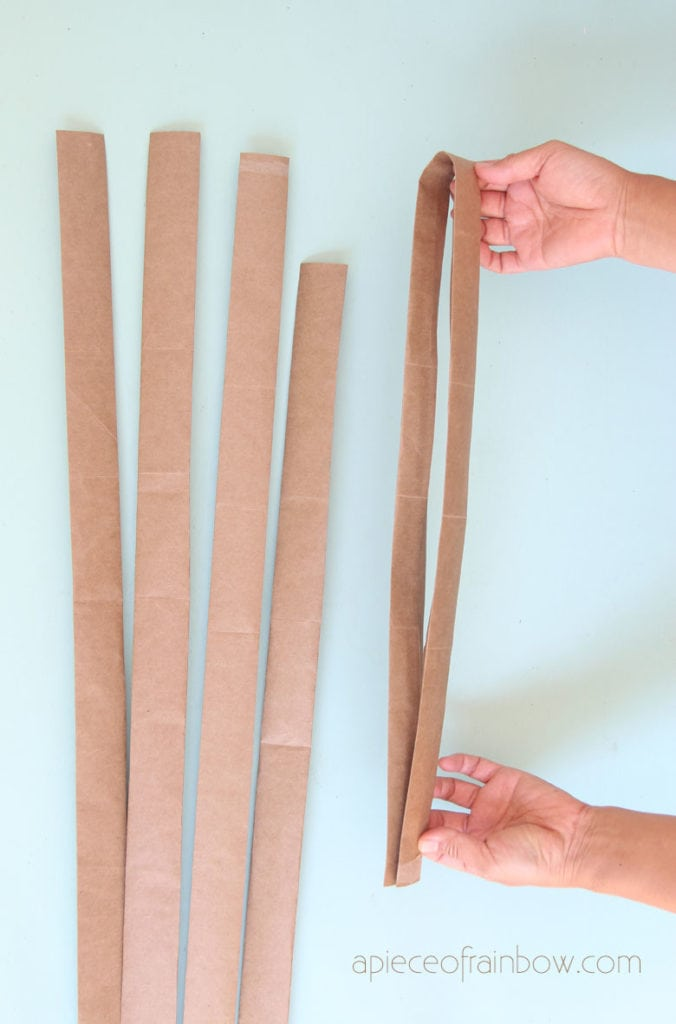 Fold thick paper strips for paper basket weaving
