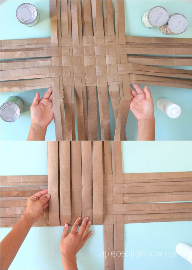 Fold each strip along the bottom edge of the lattice base to start weaving sides of paper basket