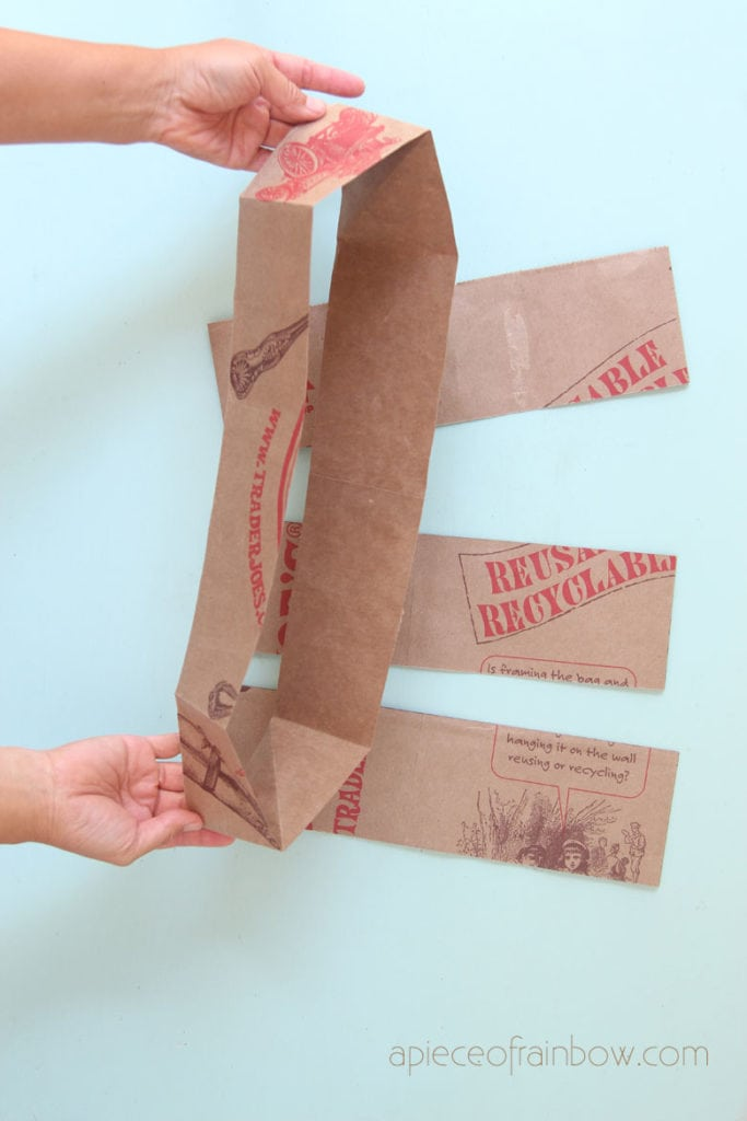 Open up each cut paper bag section