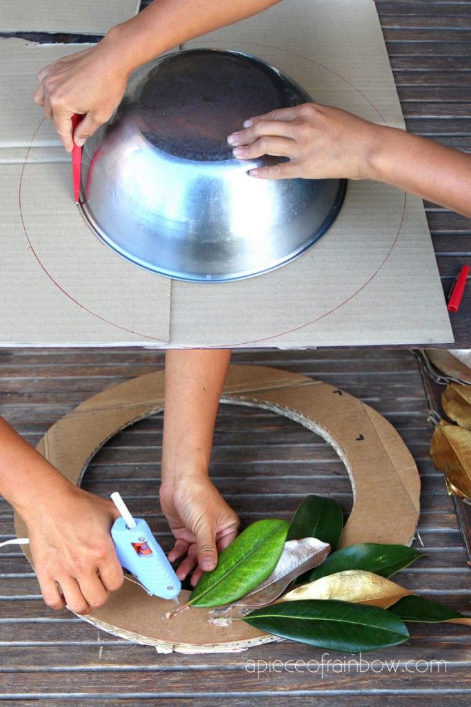 Cut a piece of cardboard to make magnolia wreath