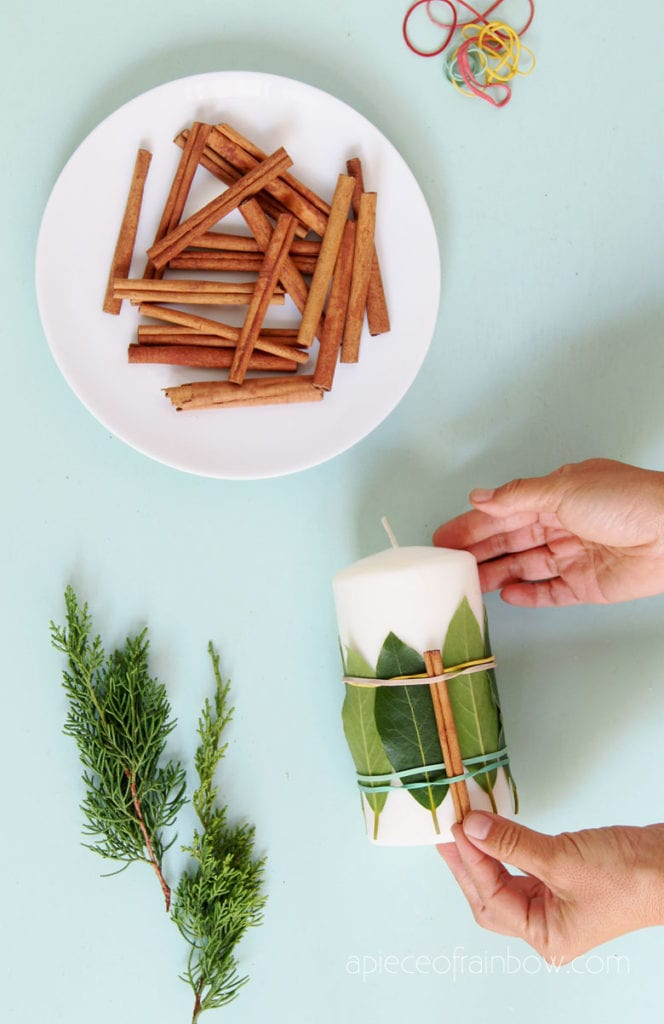 make cinnamon sticks decorated candle