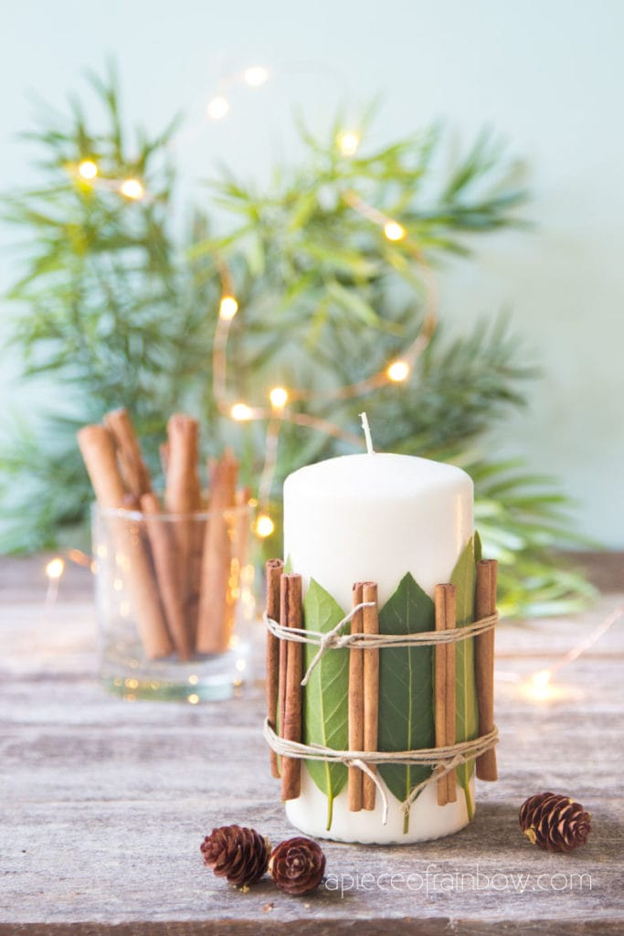 Christmas candle decorations with cinnamon sticks