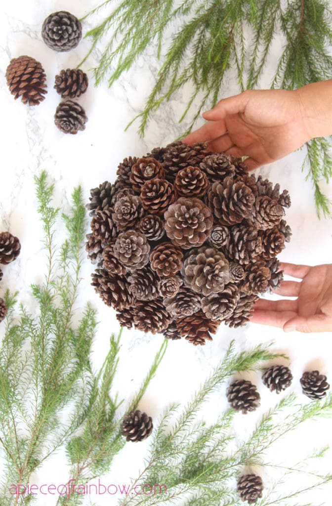 create a pine cone topiary table decoration