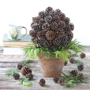 Make beautiful $1 farmhouse decor pine cone topiary with recycled paper & pinecones! Easy crafts, ornaments, & table decorations for Thanksgiving, Christmas and year-round!