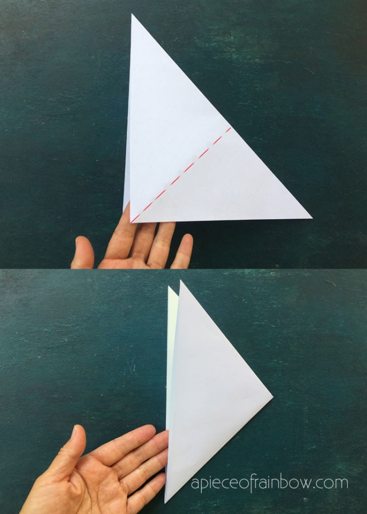 Fold the large triangle (from Step 1) in half to make a smaller triangle