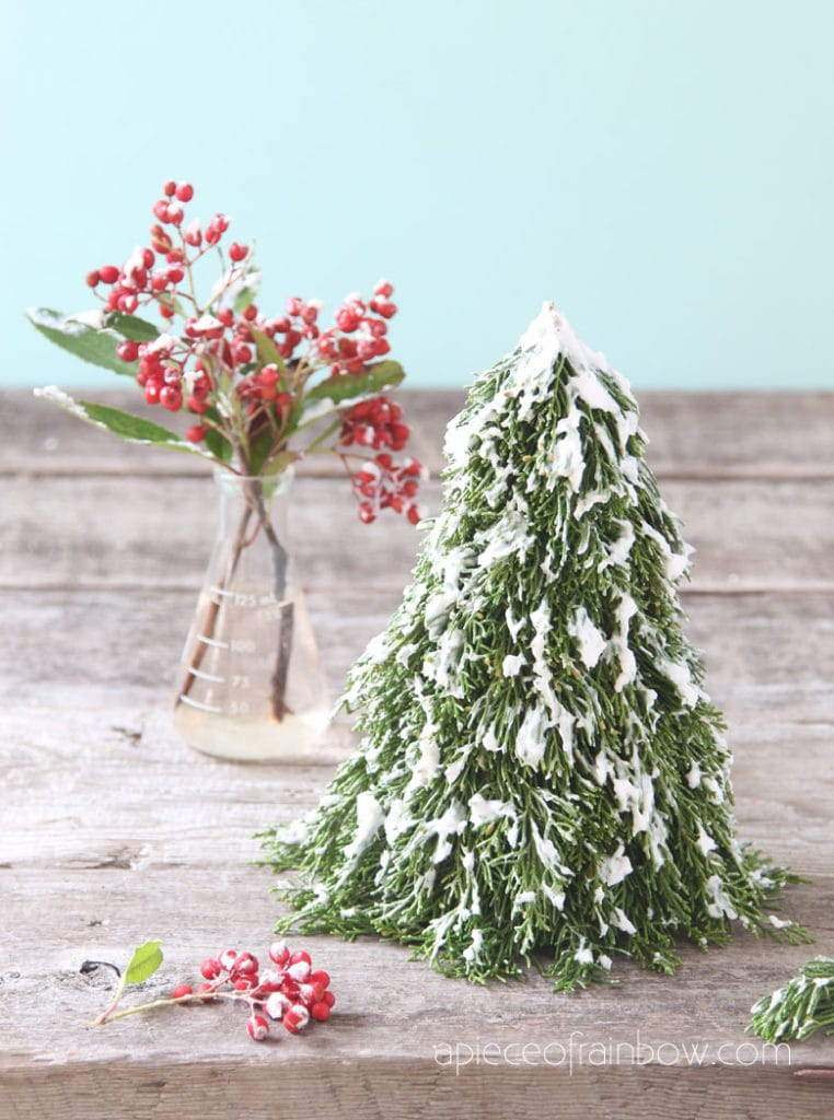 Easy winter crafts for kids and family: white soap snow flocking to make flocked Christmas trees, branches, & farmhouse decorations.