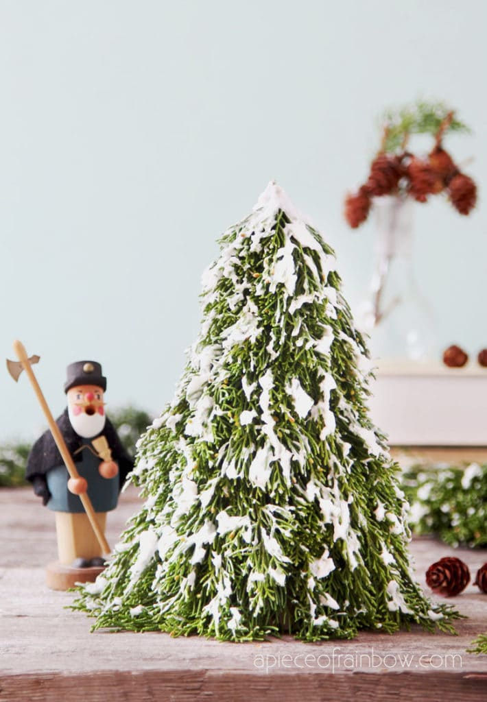 farmhouse  snow flocked Christmas tree, beautiful winter decorations