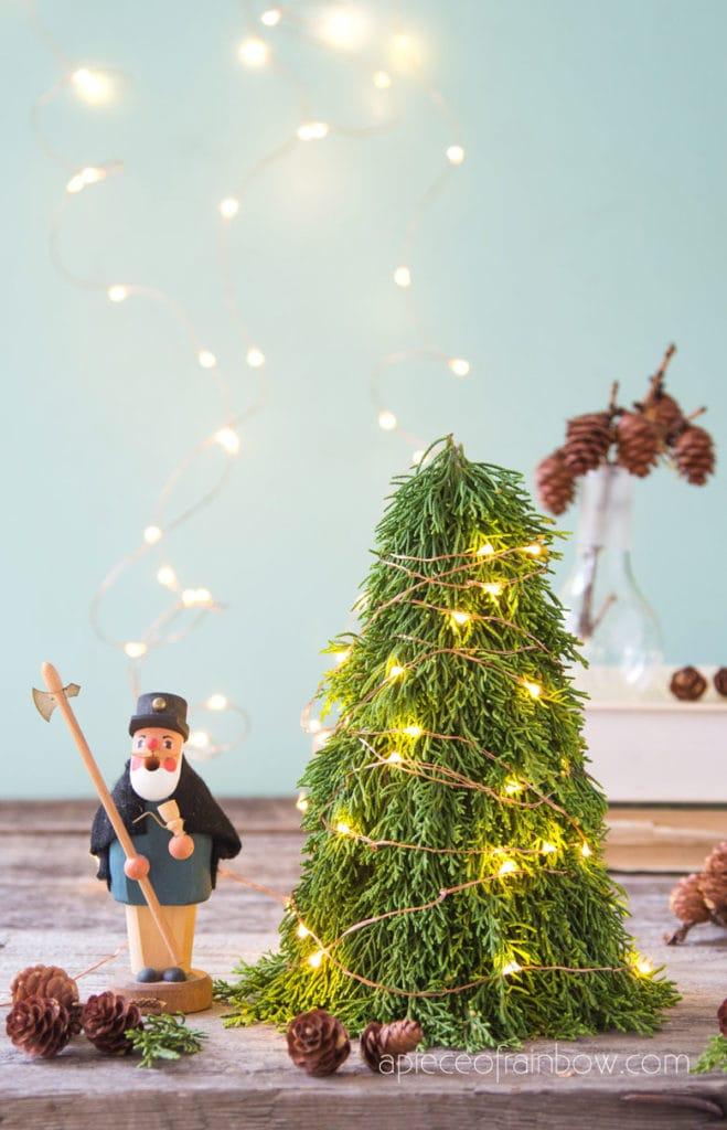 lighted mini Christmas tree on table