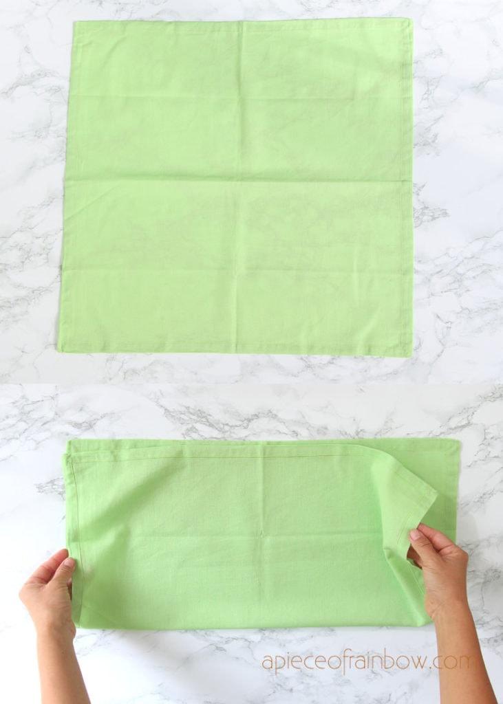 Fold the square napkin in half