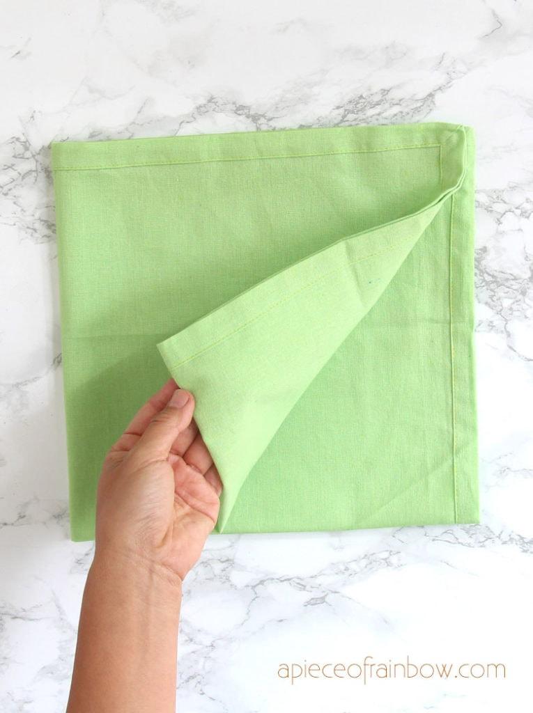 Fold the napkin into a quarter square