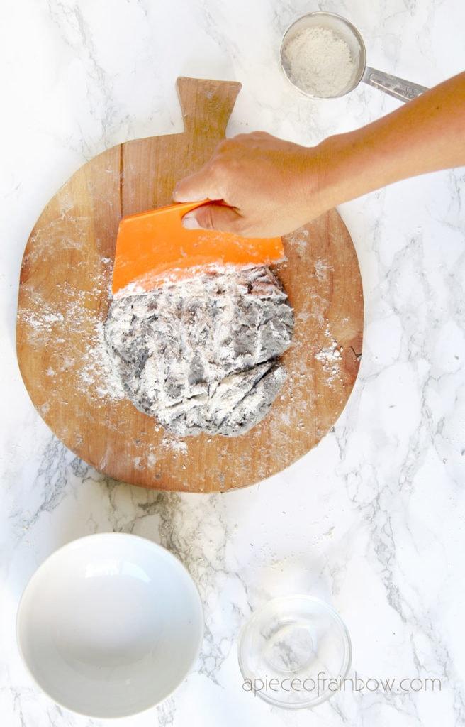 Use the dough scraper to break up the lumps in paper clay dough