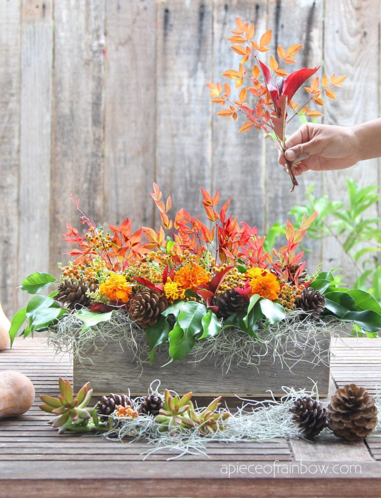 DIY Thanksgiving centerpiece with colorful fall leaves