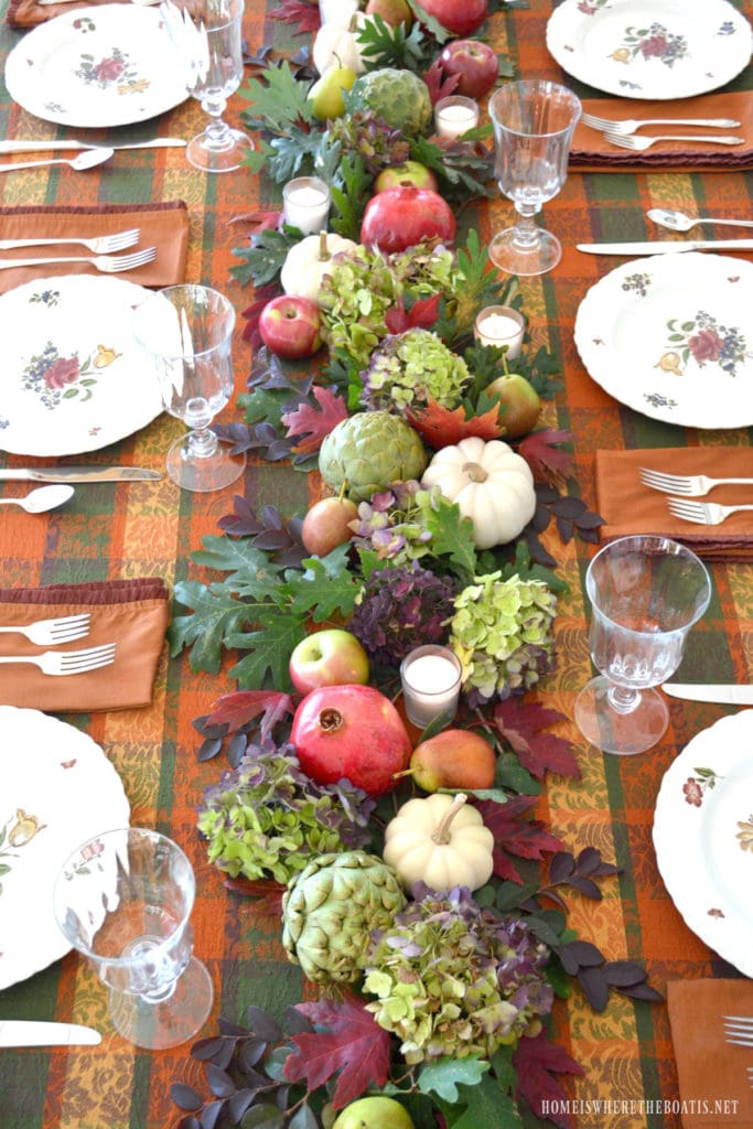Thanksgiving table runner style garland made with fruits and flowers