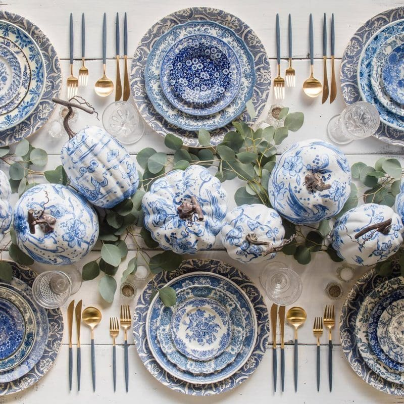 Thanksgiving table settings with decorated blue and white pumpkins