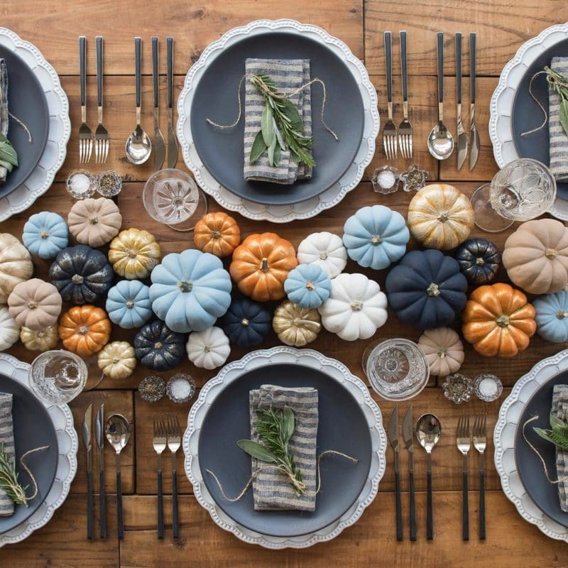 Thanksgiving pumpkin decorations painted navy, light blue and gold,