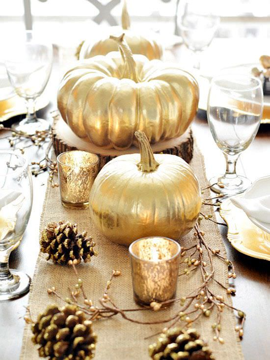 modern Thanksgiving table is decorated with painted gold pumpkins
