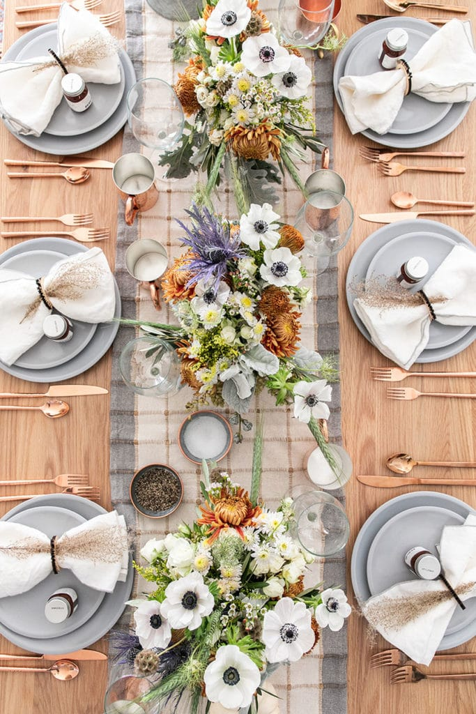 rustic Modern Thanksgiving table settings with flower arrangements