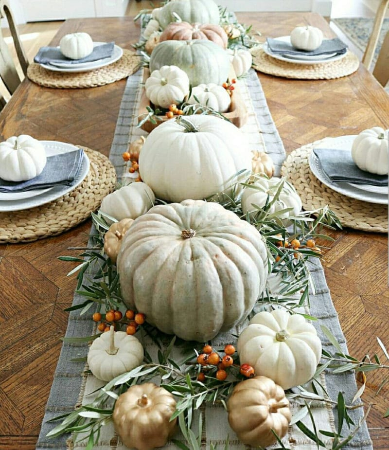 Beautiful farmhouse Thanksgiving table decorationswith soft blue and white pumpkins
