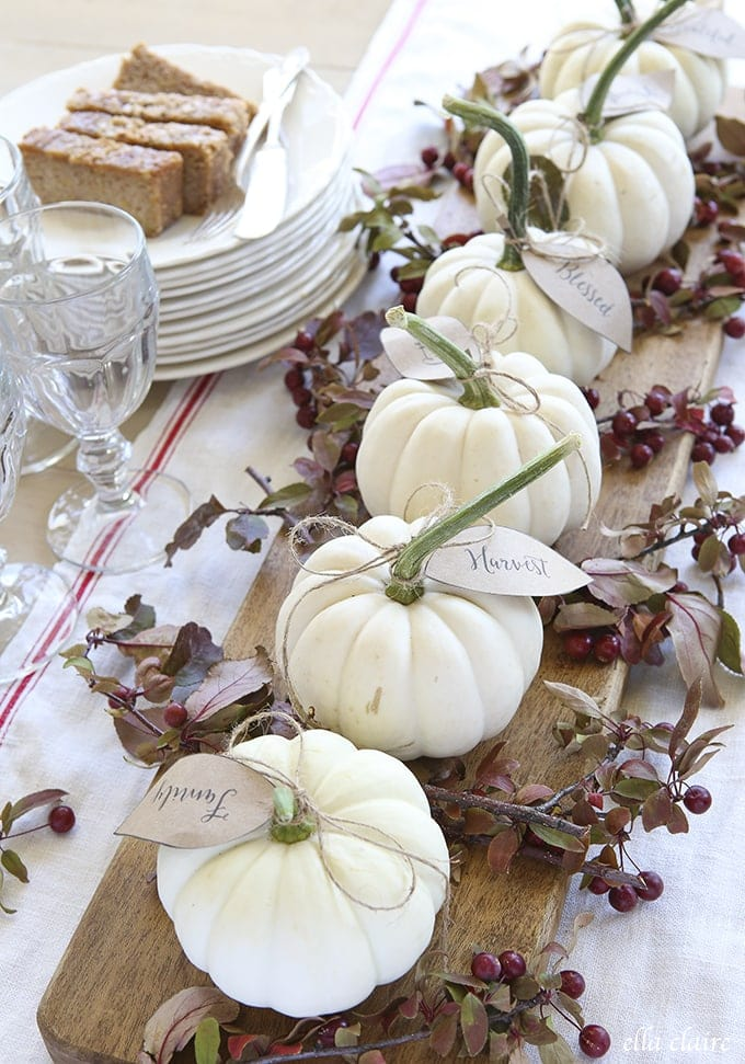 Vintage farmhouse Thanksgiving table settingswith grain sack table linen and rustic wood tray