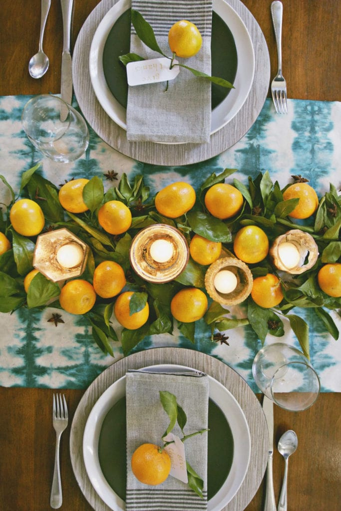 citrus garland with candles and citrus place cards